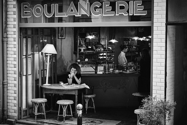 woman in bordeaux cafe